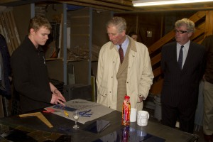 HRH Prince Charles testing the apprentice's cutting skills